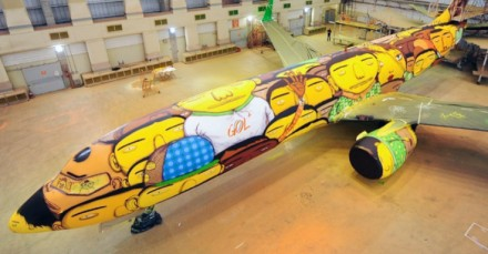 Os Gemeos paint Brazil's World Cup plane.